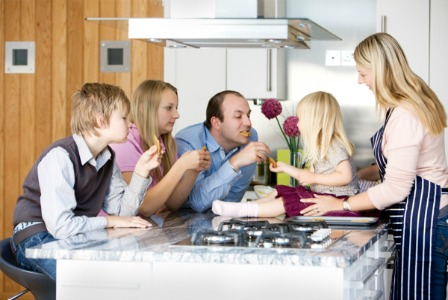 family-eating-cookies-in-the-kitchen